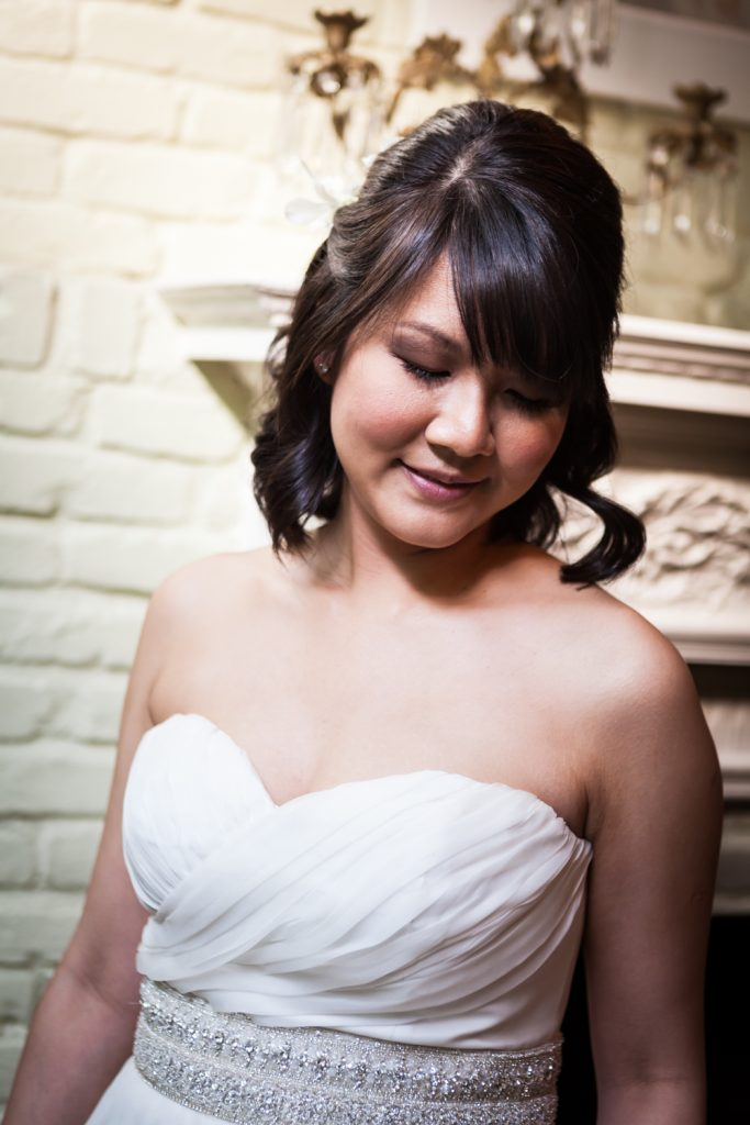 Portrait of bride wearing strapless white dress at an Alger House wedding