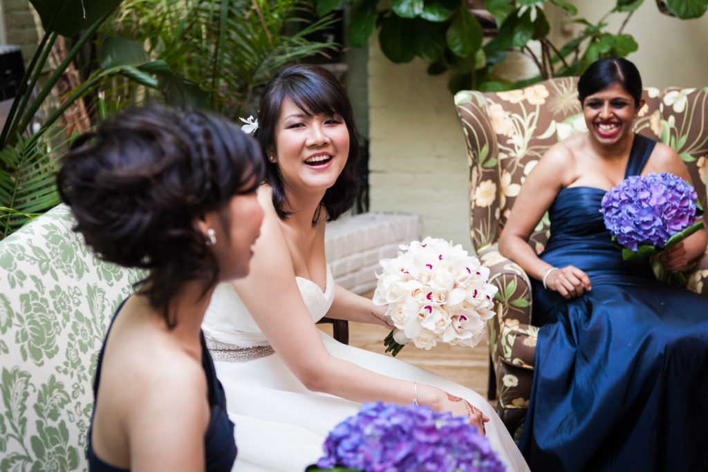 Bride in white dress laughing with bridesmaids at an Alger House wedding