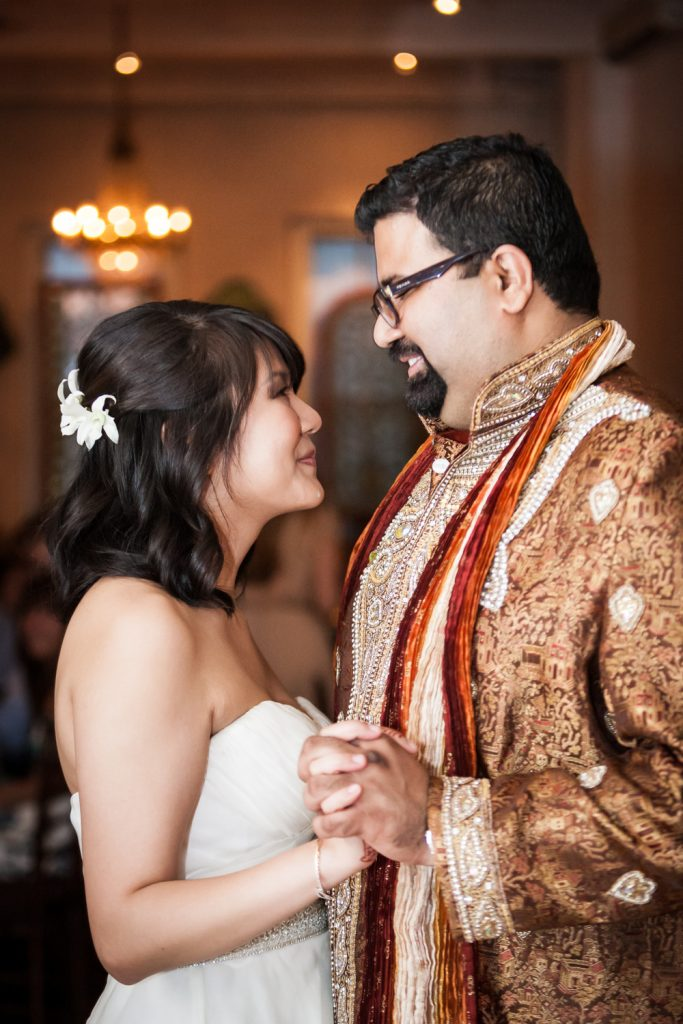 Bride and groom wearing traditional Indian attire during first dance at an Alger House wedding