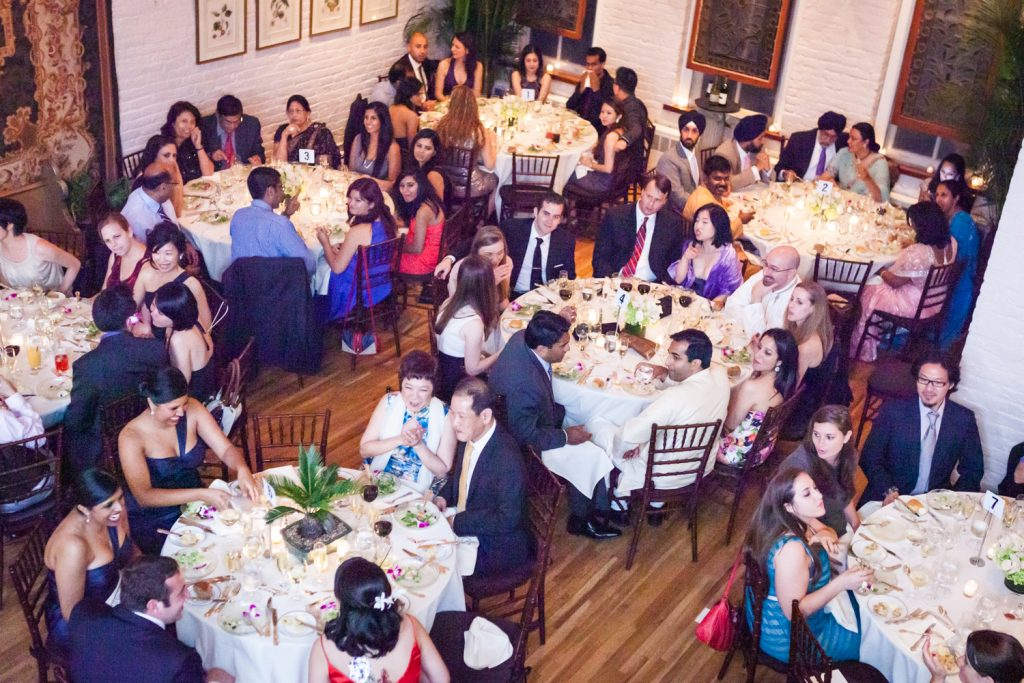 Wide shot of guests sitting at tables at an Alger House wedding