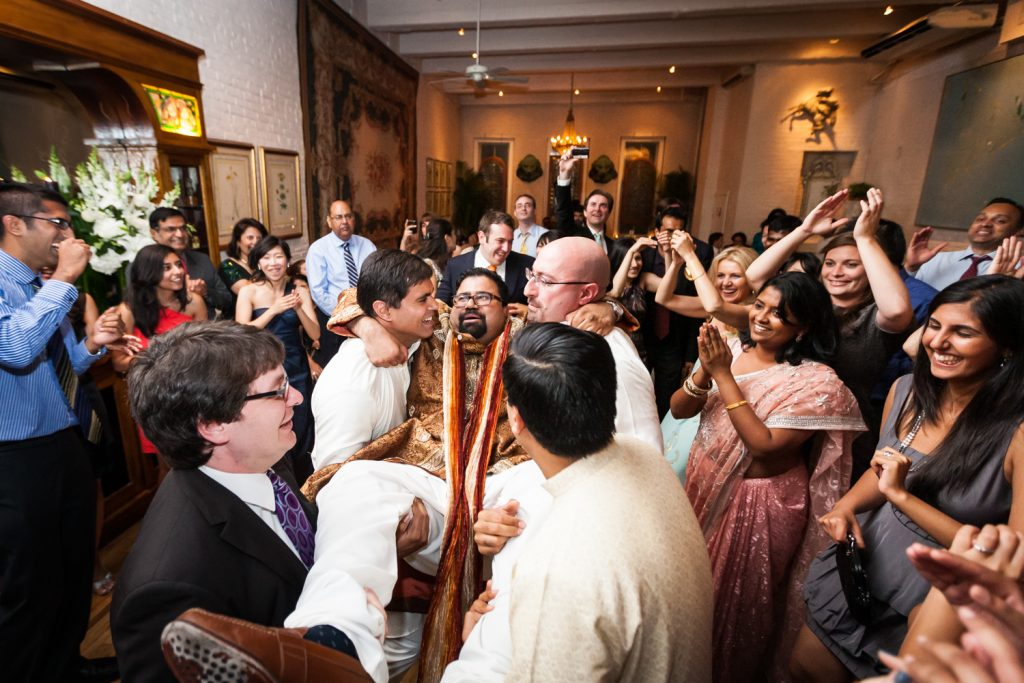 Guests lifting up groom at an Alger House wedding