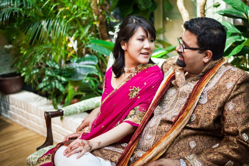 Bride and groom wearing traditional Indian attire at an Alger House wedding