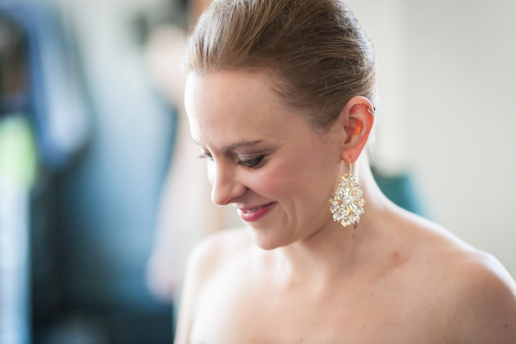 Bride wearing sparkly earring at a Brooklyn Bridge Park wedding