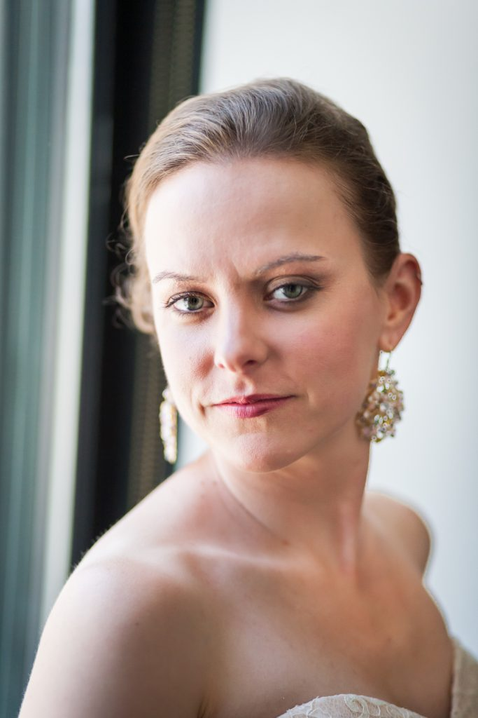 Portrait of bride wearing sparkly earrings at a Brooklyn Bridge Park wedding