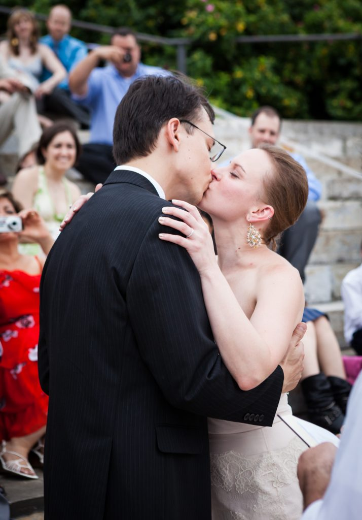 Bride and groom kissing after ceremony at a Brooklyn Bridge Park wedding