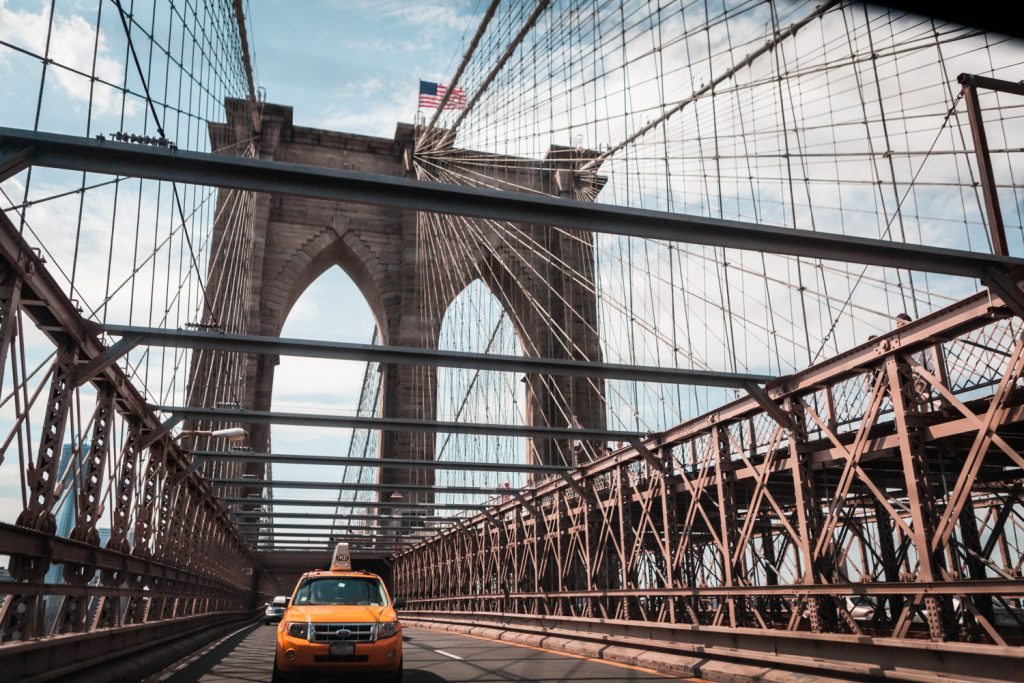 Taxi cab driving across Brooklyn Bridge