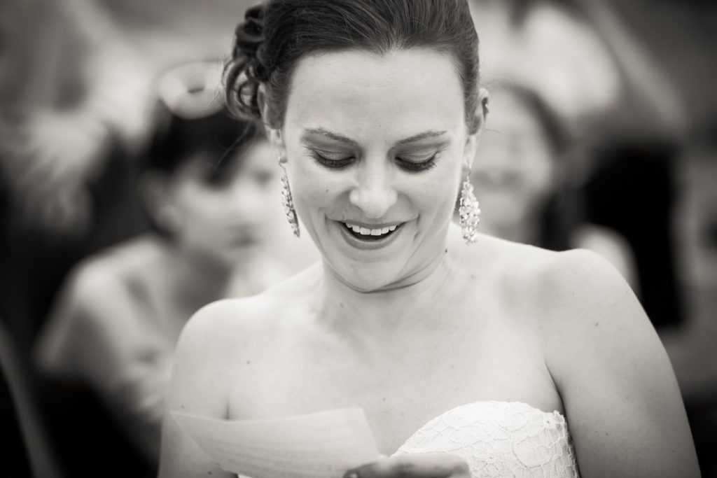 Black and white photo of bride saying vows