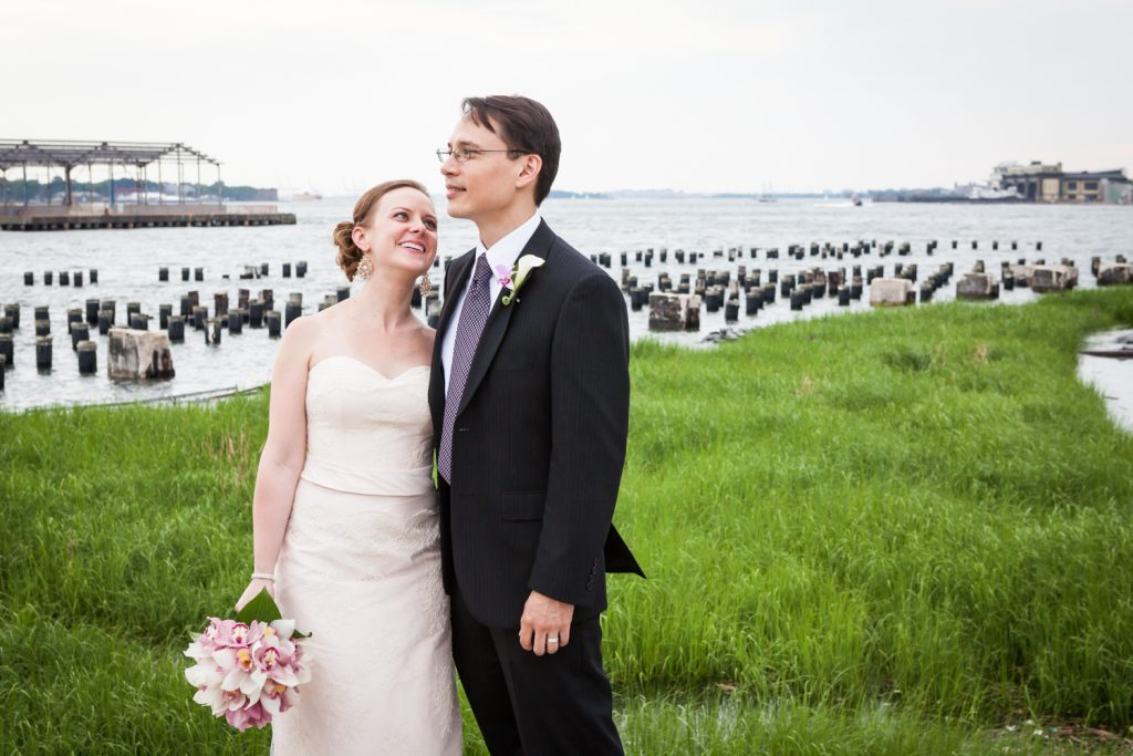 Bride looking up at groom at a Brooklyn Bridge Park wedding