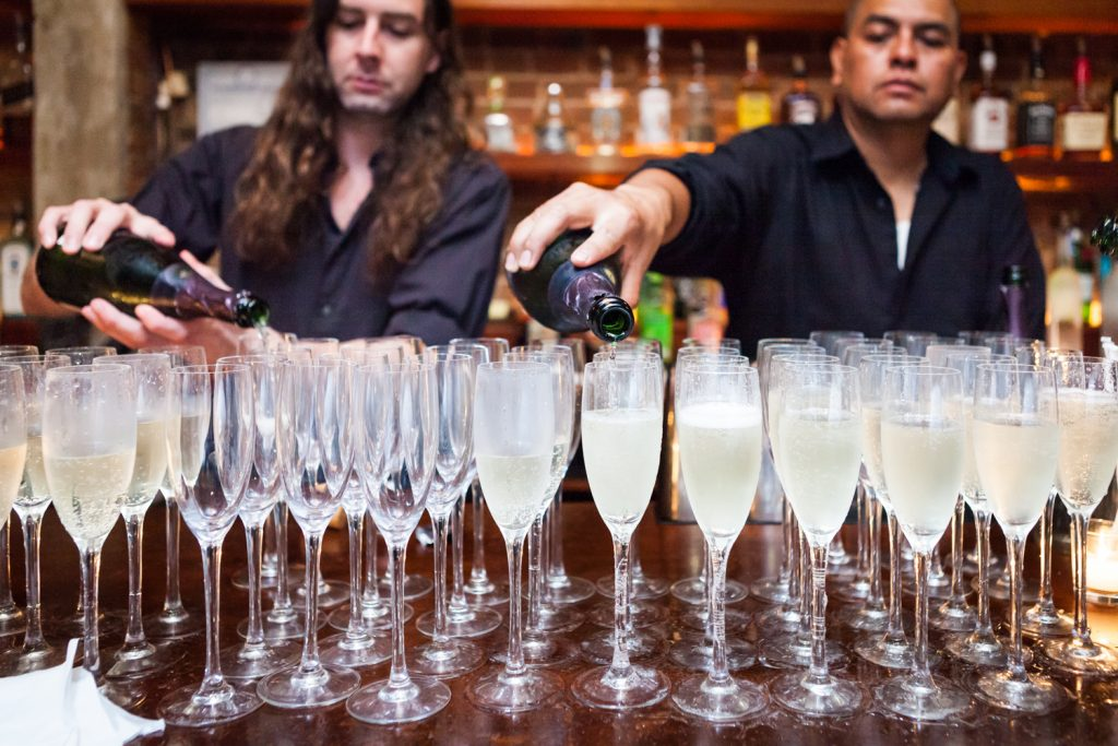 Bar staff pouring champagne during Williamsburg wedding reception