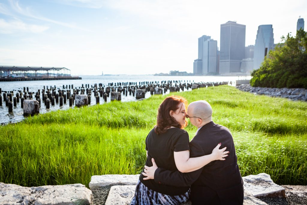 Couple kissing with abandoned dock poles in background