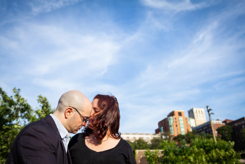 Couple against wide open sky during a Brooklyn Bridge Park engagement portrait session