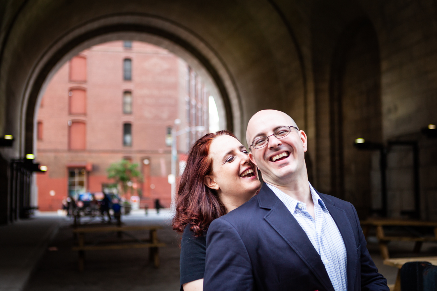 Couple in front of DUMBO Archway