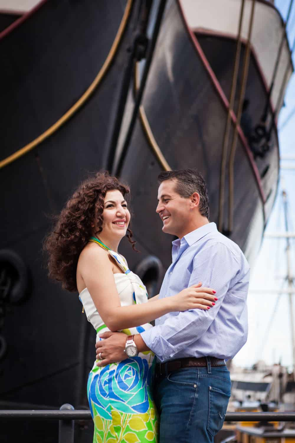 Financial District engagement photos of couple in front of ship