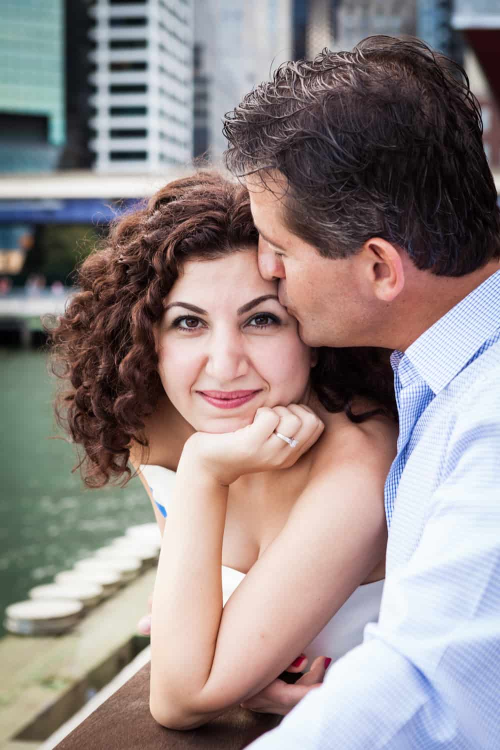 Financial District engagement photos of man kissing woman on the forehead