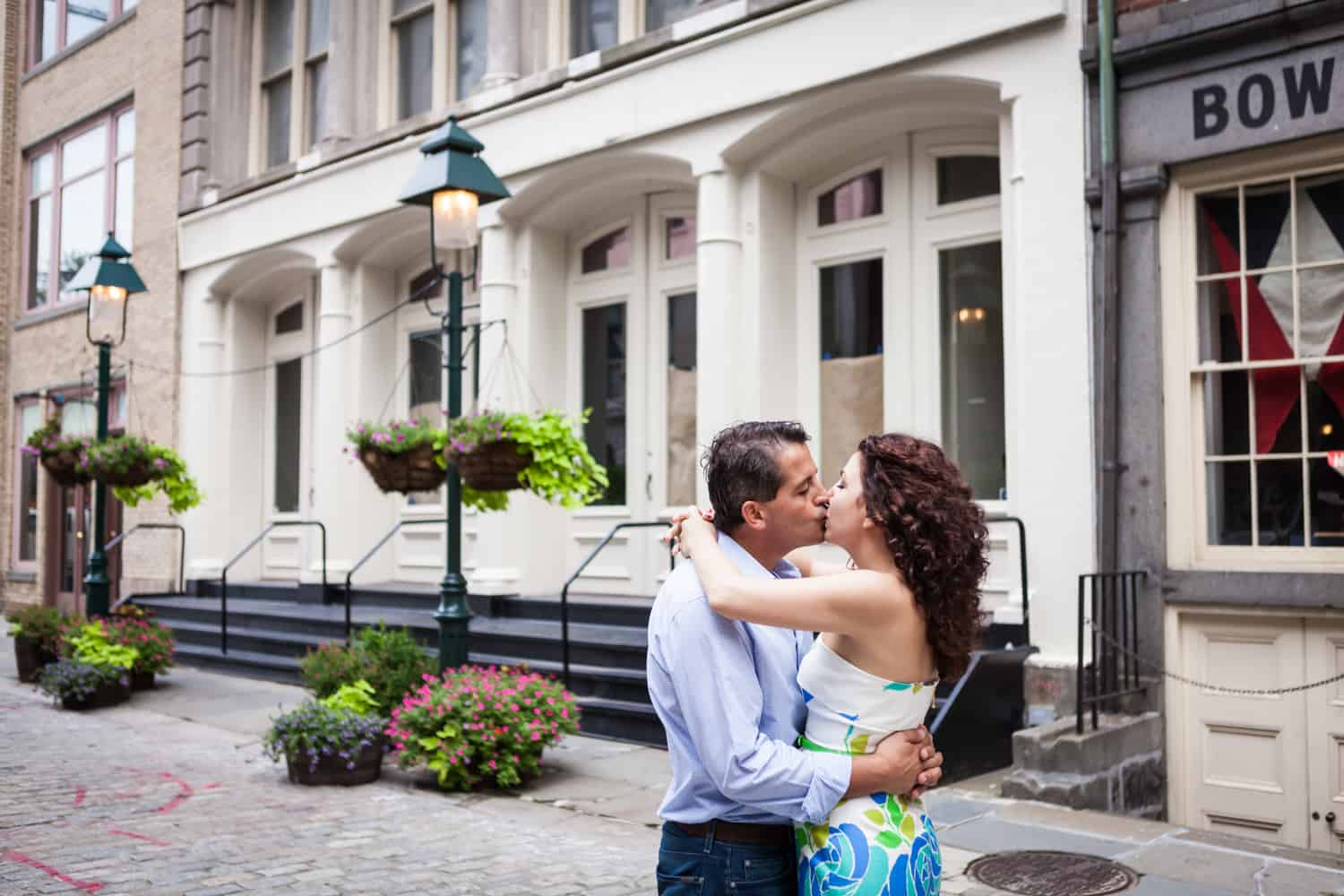 Financial District engagement photos of couple kissing at south Street Seaport