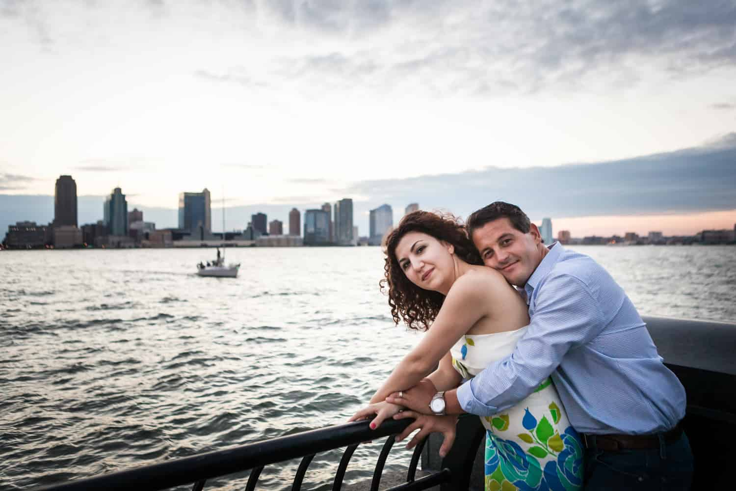 Couple hugging in front of NYC waterfront