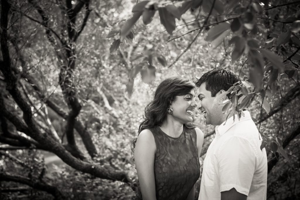 Black and white photo of couple in forest
