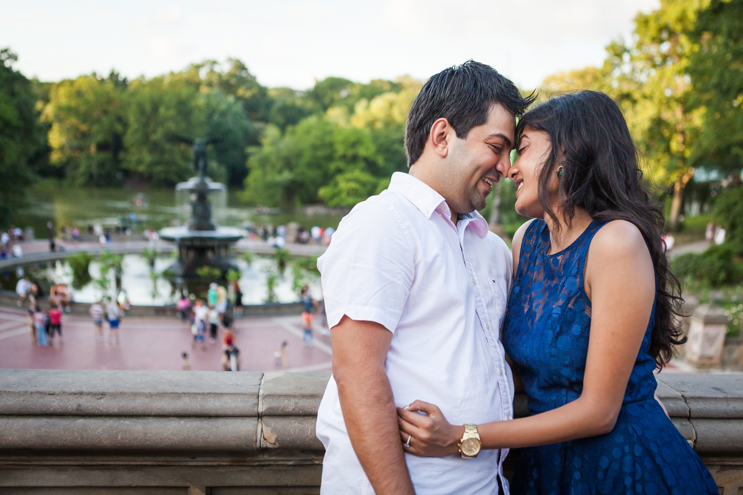 Couple hugging with Bethesda Fountain in the background