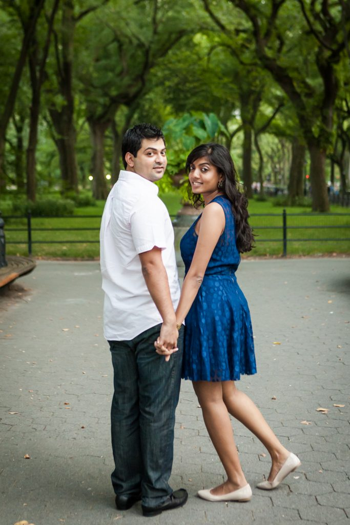 Couple holding hands and walking on the Mall in Central Park