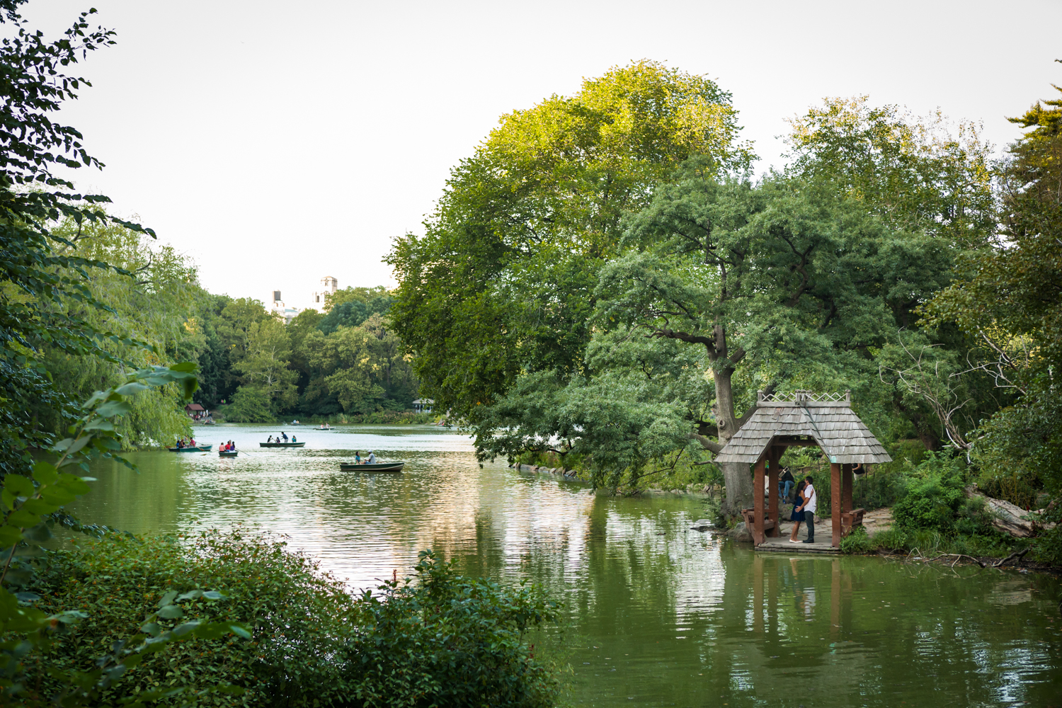 Wide shot of Central Park lake and wooden chalet