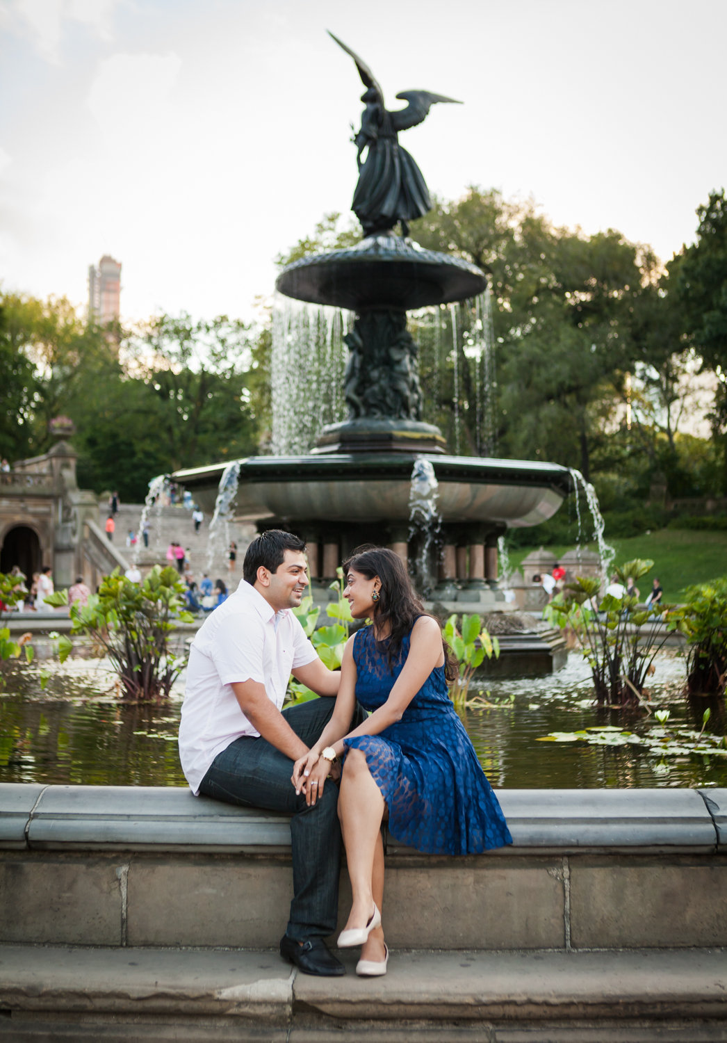 Couple sitting on edge of Bethesda Fountain in Central Park