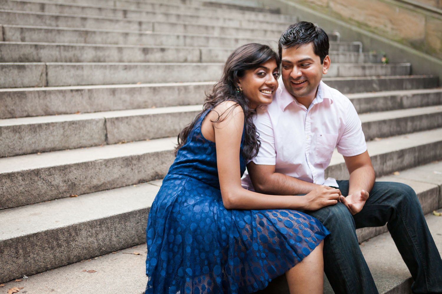 Couple sitting on steps during a Central Park engagement shoot