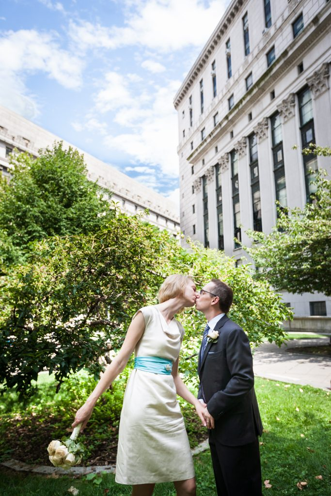 Couple kissing in garden at a NYC City Hall wedding
