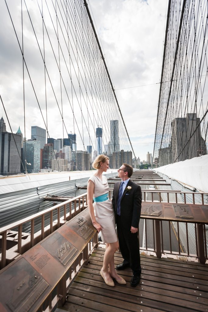 Couple on Brooklyn Bridge at a NYC City Hall wedding