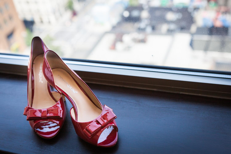 Red kitten heels in a windowsill
