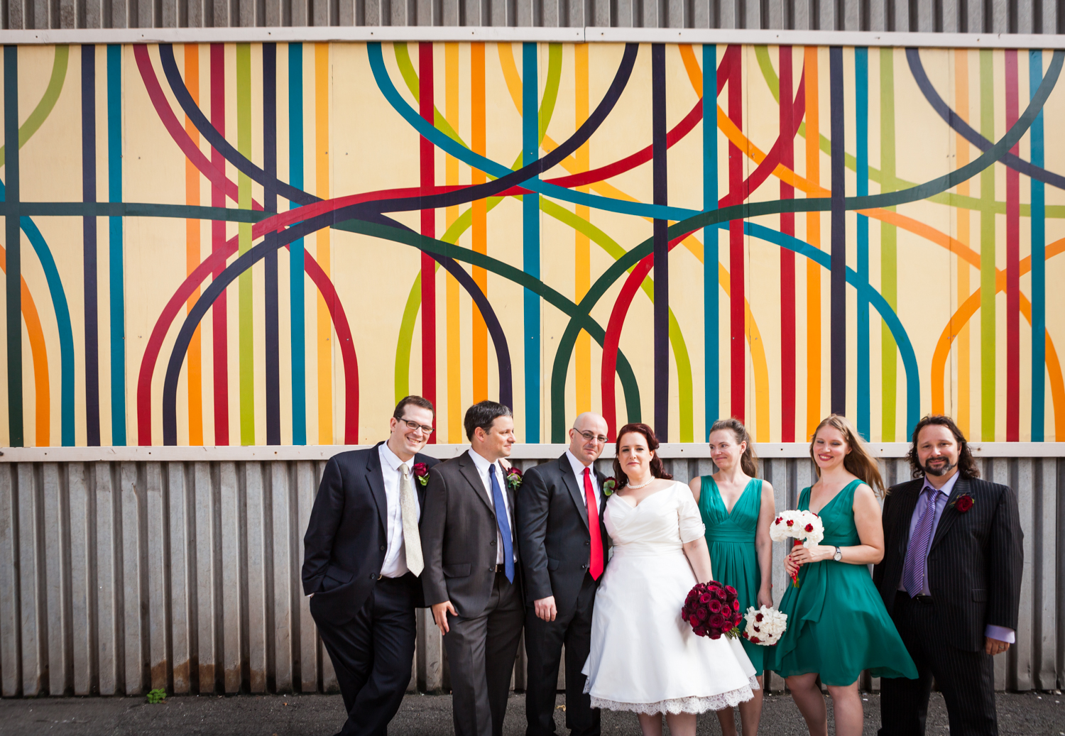 Bridal party standing in front of DUMBO mural