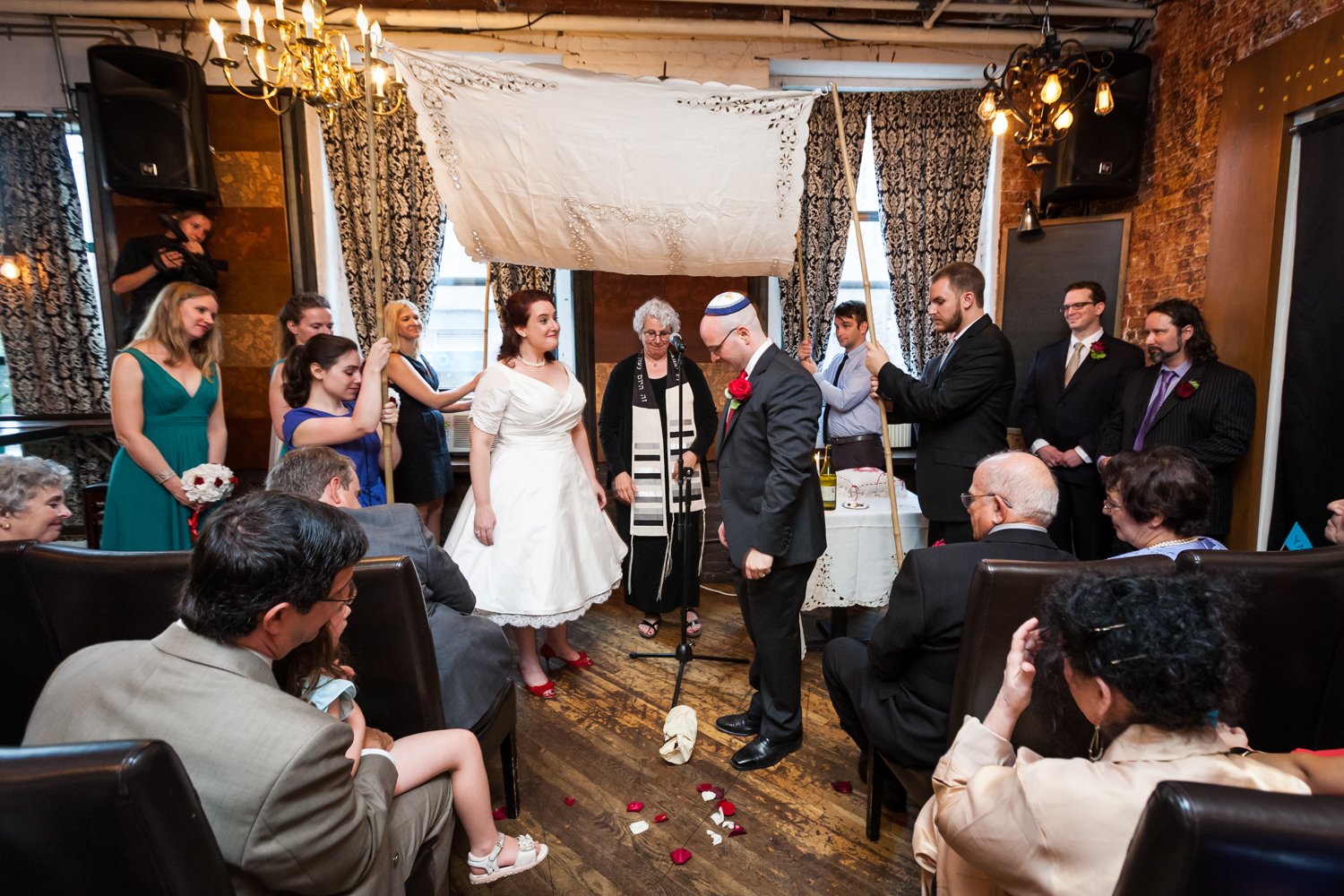 Jewish wedding ceremony with groom about to step on glass at a DUMBO wedding
