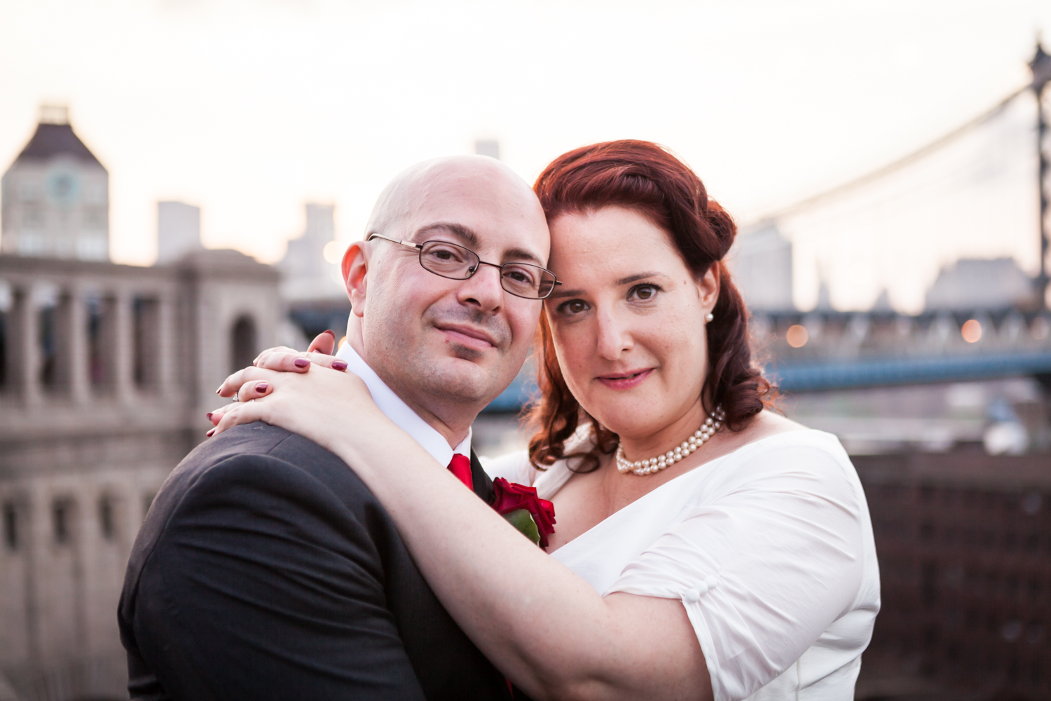 Bride and groom at sunset with Manhattan Bridge in background