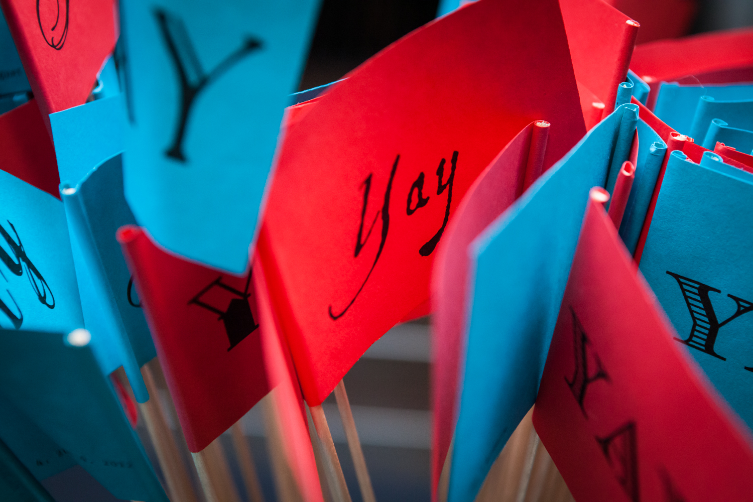 Close up on red and blue flags with the word 'Yay!'