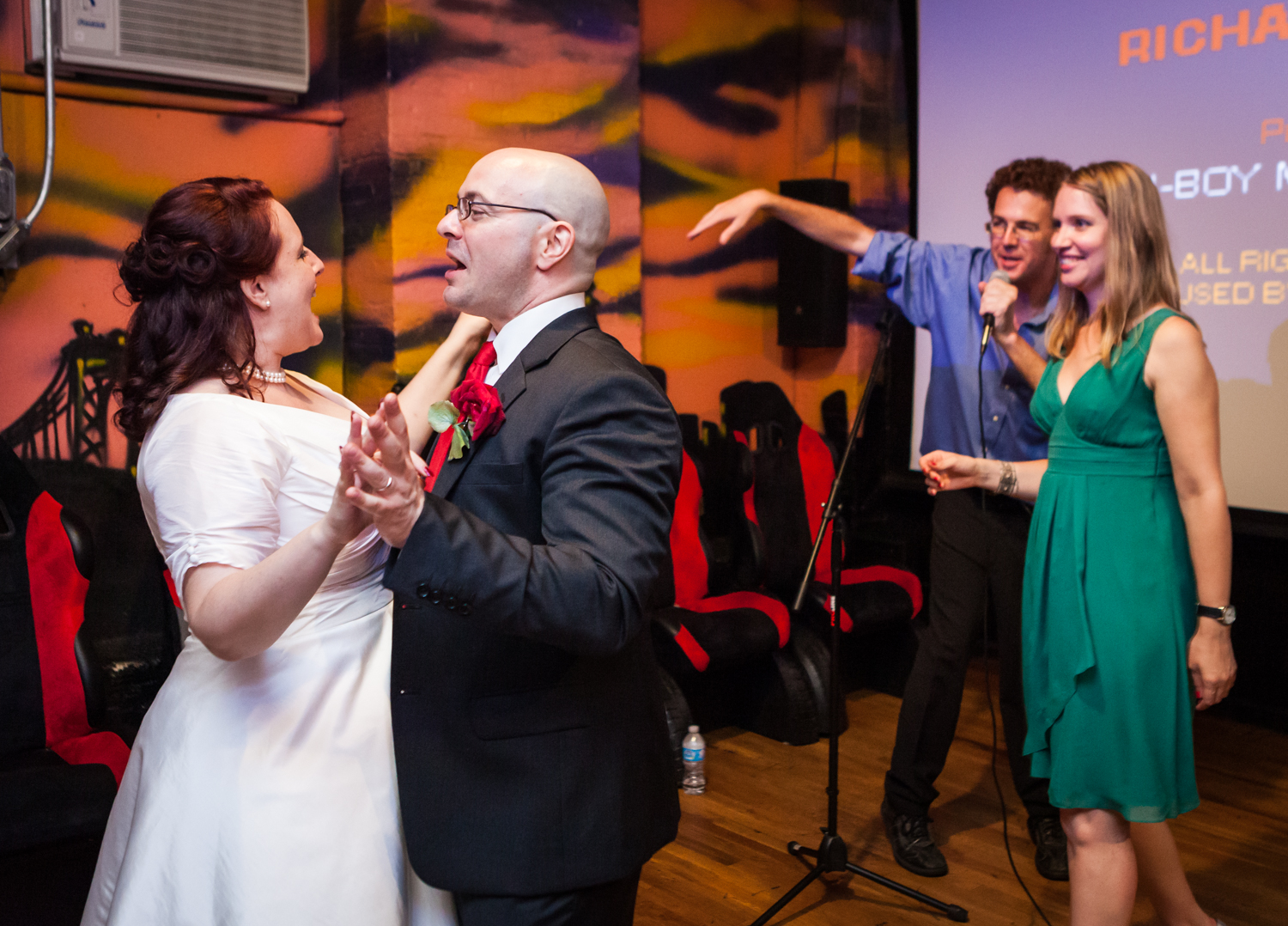 Bride and groom dancing with other couple to right