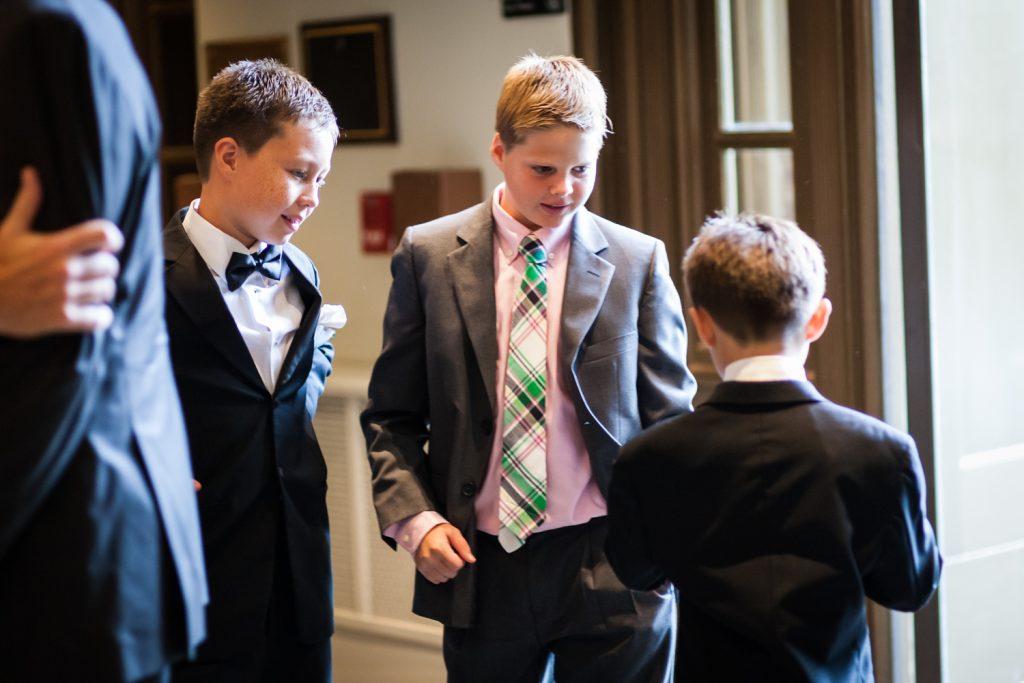 Three boys playing around before wedding ceremony