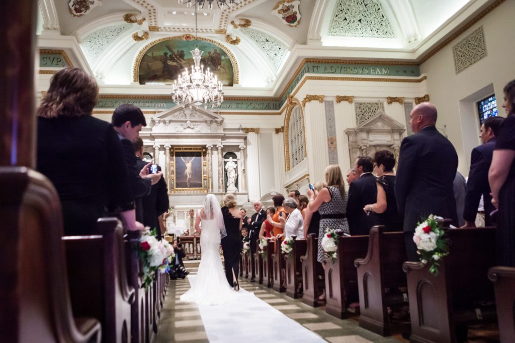 Bride and groom walking up aisle at St. Peter's Church wedding ceremony