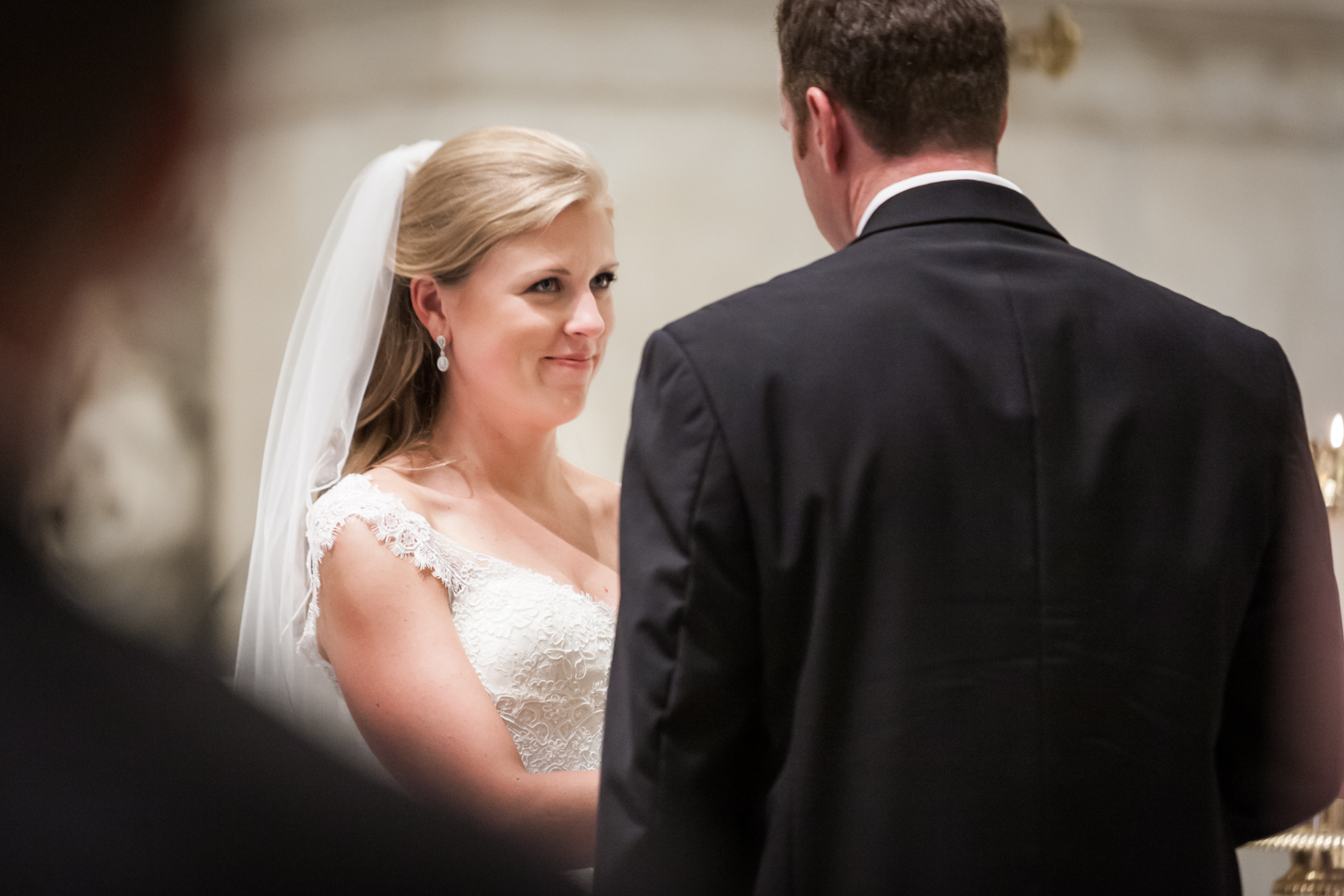 Bride listening to groom during St. Peter's Church wedding ceremony