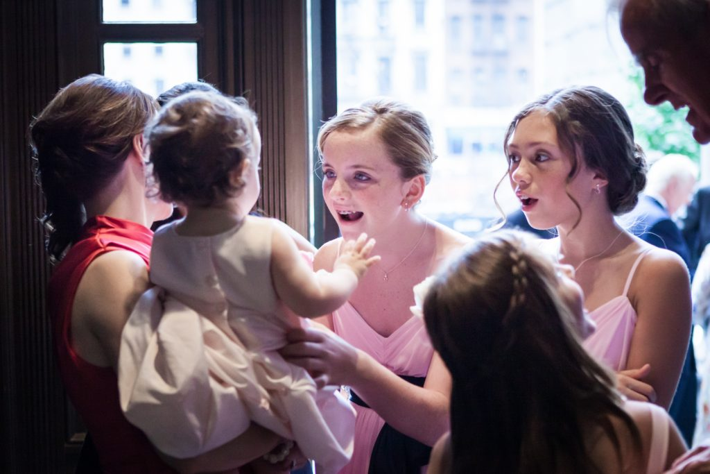 Young girls playing with baby after St. Peter's Church wedding ceremony