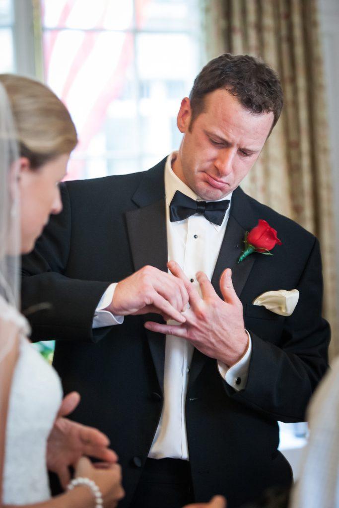 Groom taking off ring at a Harvard Club NYC wedding