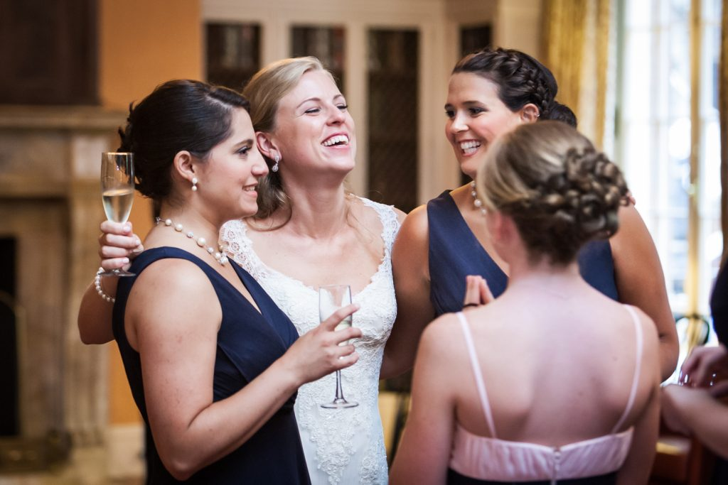 Bride talking with girlfriends during cocktail hour at a Harvard Club NYC wedding