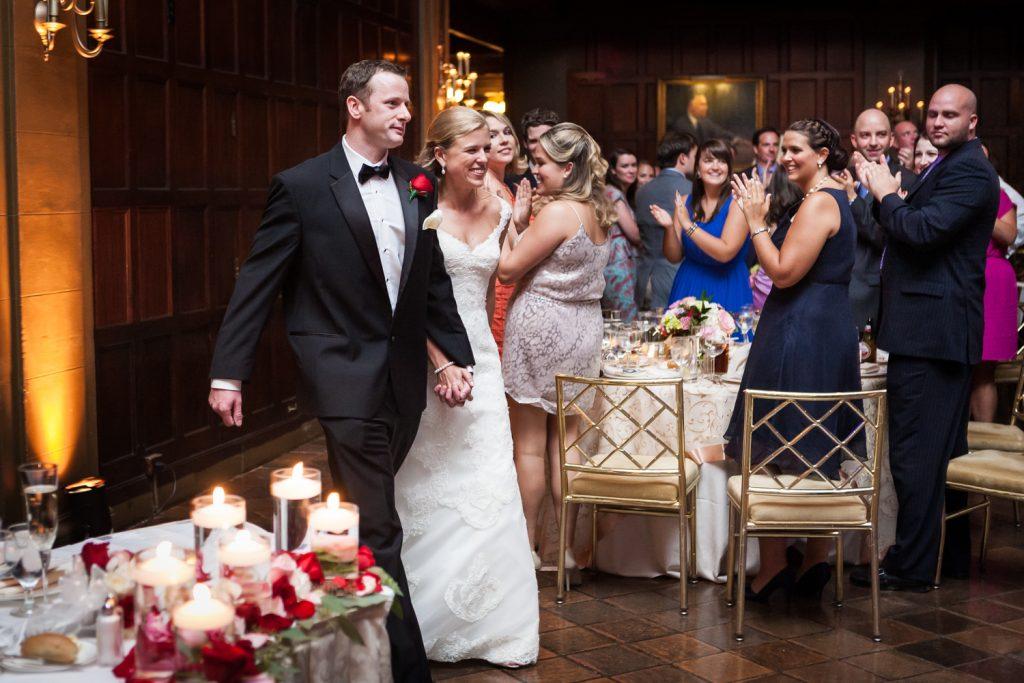 Bride and groom entering reception at a Harvard Club NYC wedding