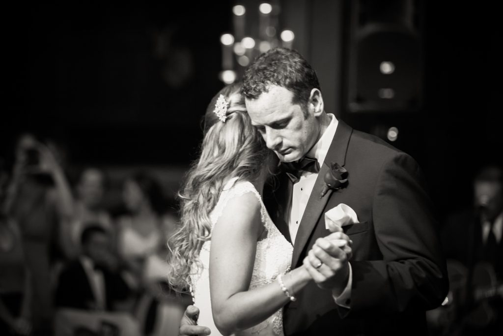 Black and white photo of groom and bride during first dance