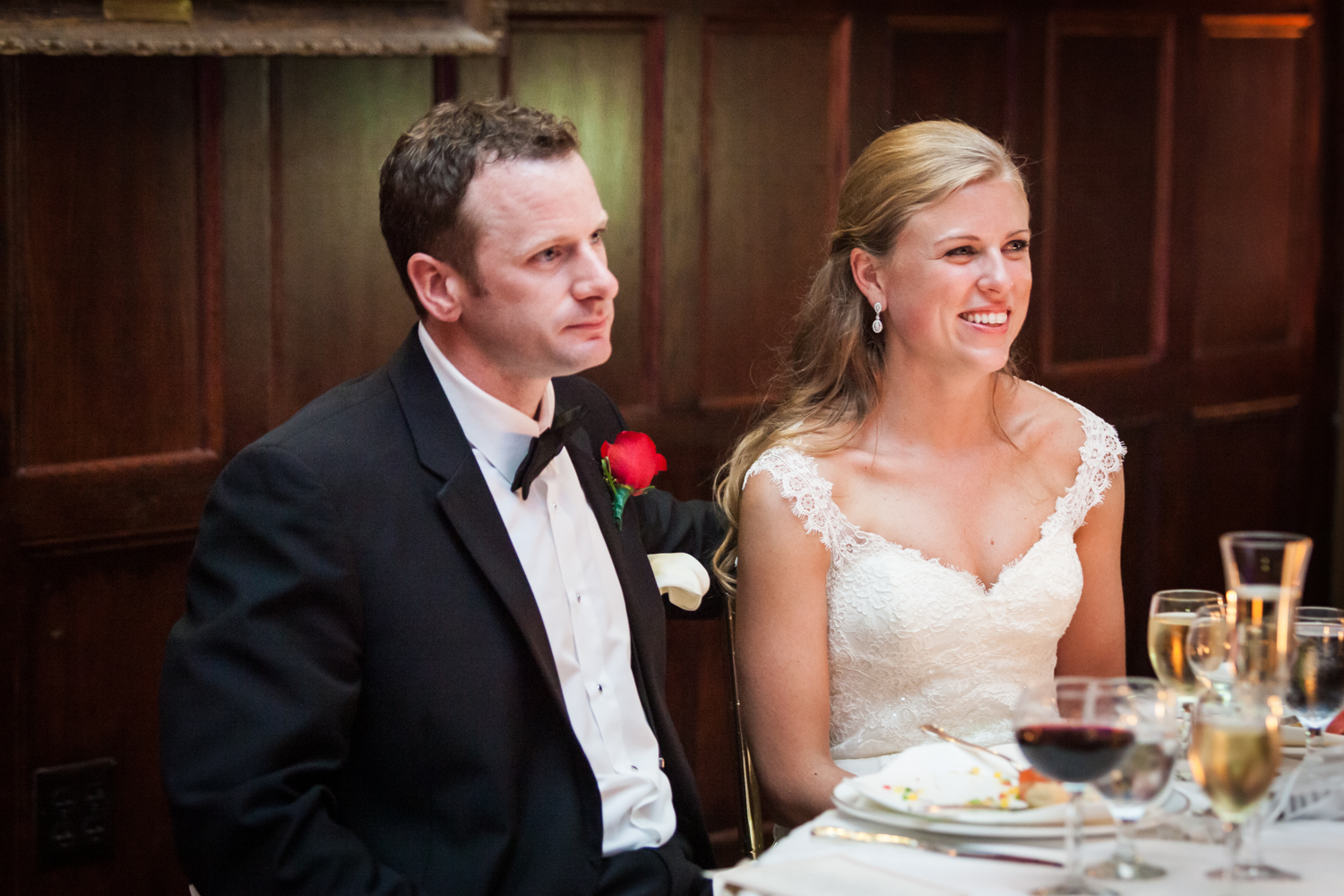 Bride and groom listening to speeches at a Harvard Club NYC wedding