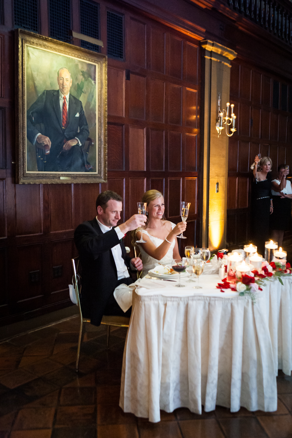 Bride and groom raising champagne glasses at a Harvard Club NYC wedding