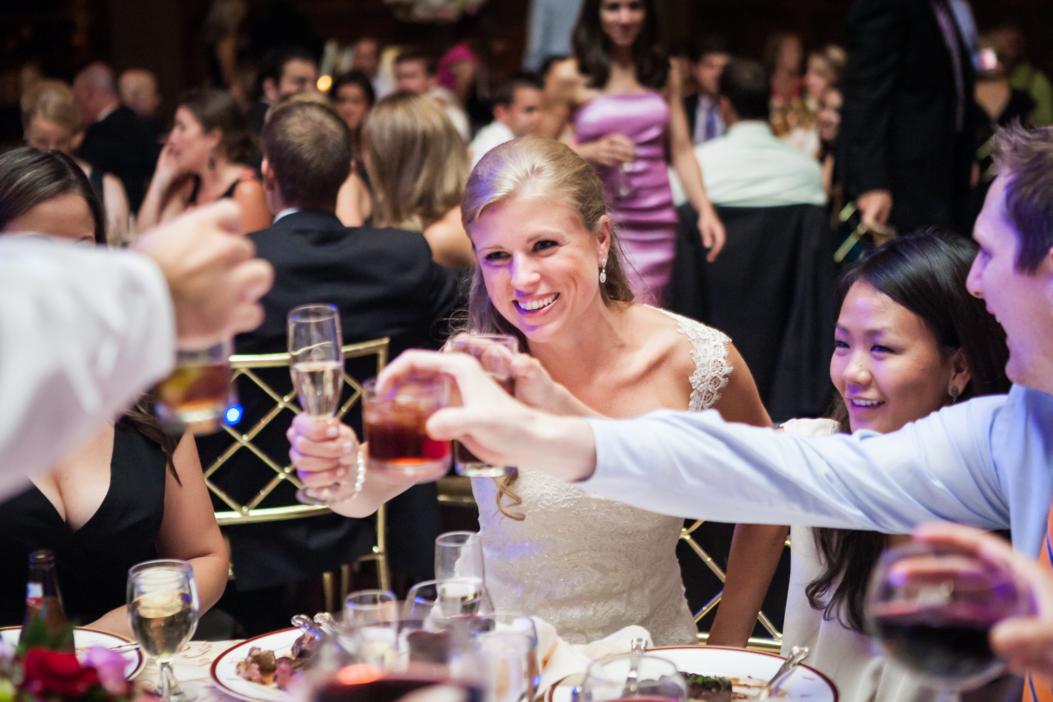 Bride raising glass with guests at a Harvard Club NYC wedding