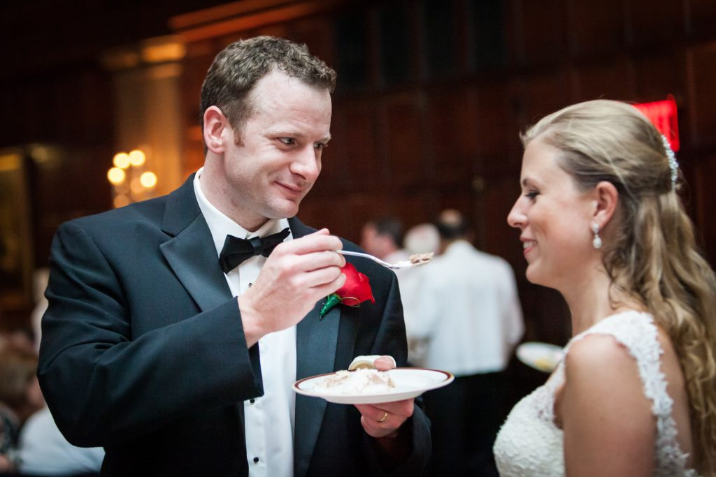 Groom feeding cake to bride at a Harvard Club NYC wedding