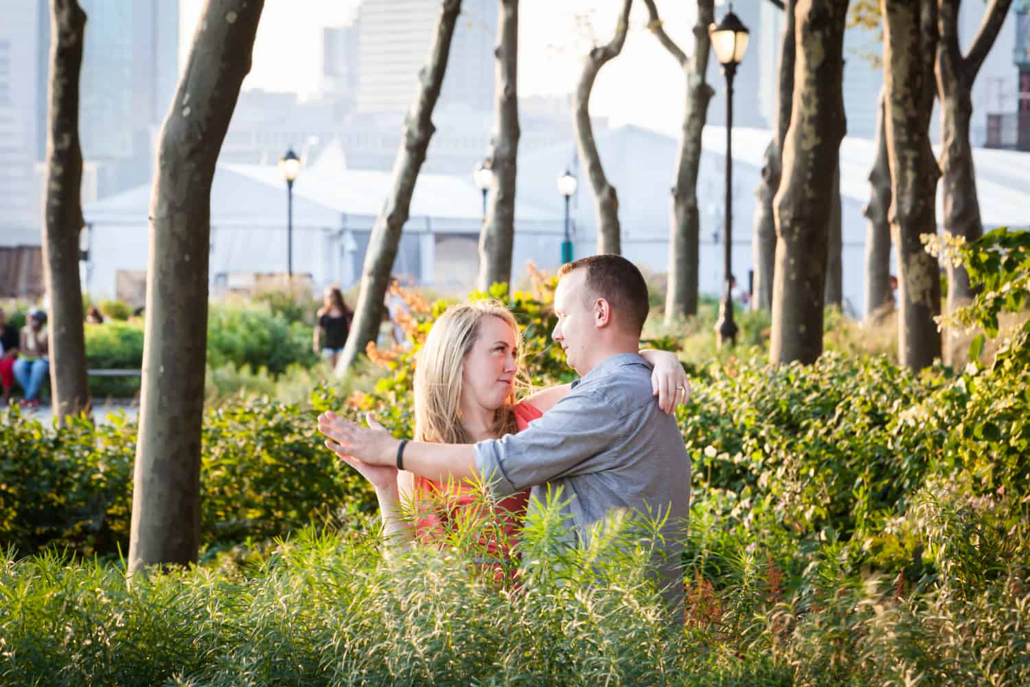 Couple dancing in park at a Battery Park engagement shoot