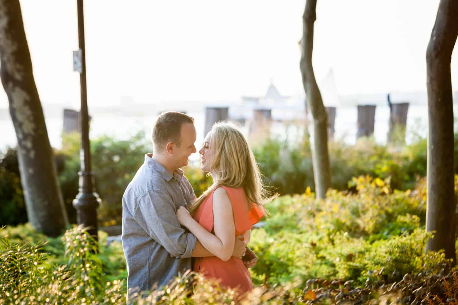 Couple hugging in middle of park at a Battery Park engagement shoot
