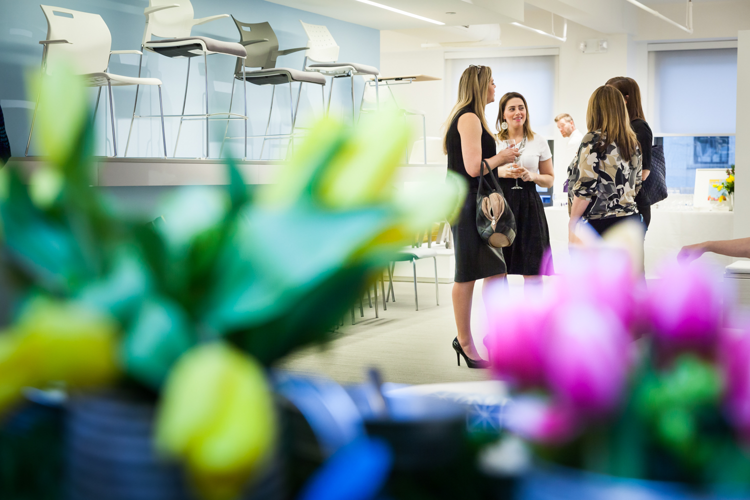 Guests talking at a corporate cocktail party for an article on corporate event planning tips