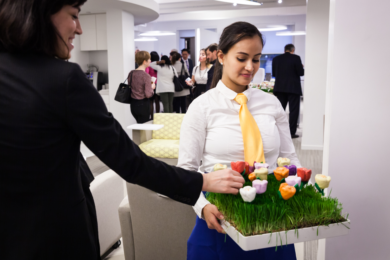 Waiter offering appetizers to a guest for an article on corporate event planning tips
